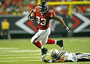 ATLANTA - AUGUST 29:  Running back Michael Turner #33 of the Atlanta Falcons is tripped up by cornerback Antoine Cason #20 of the San Diego Chargers during the game at the Georgia Dome on August 29, 2009 in Atlanta, Georgia.  The Falcons beat the Chargers 27-24.  (Photo by Mike Zarrilli/Getty Images)
