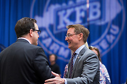 Lexington Mayor Jim Gray, right, greets other attendees during the 53rd Annual Kentucky Farm Beureau Country Ham Breakfast was protested by Congressman John Yarmuth, Chris Hartman and other members of various fairness organizations outside the South Wing of the Kentucky Fair and Exposition Center, Thursday, Aug. 25, 2016 in Louisville.