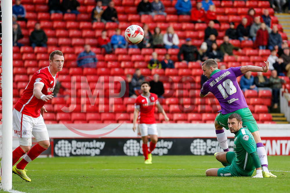 Aaron Wilbraham of Bristol City hits a header just wide as Ross Turnbull of Barnsley looks on - Photo mandatory by-line: Rogan Thomson/JMP - 07966 386802 - 25/10/2014 - SPORT - FOOTBALL - Barnsley, England - Oakwell Stadium - Barnsley v Bristol City - Sky Bet League 1.