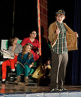 The Ronettes (Jennie Veloski, Katie Tarr, Kathy Lipshultz and Nicole Rosas) and Seymour Krelborn (Keiran Harpell) hang out on skid row during dress rehearsal for Little Shop of Horrors presented by Belmont High School drama.  (Karen Bobotas/for the Laconia Daily Sun)