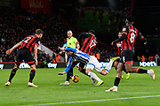 Joshua King (17) of AFC Bournemouth takes the ball off Ramadan Sobhi (14) of Huddersfield Town during the Premier League match between Bournemouth and Huddersfield Town at the Vitality Stadium, Bournemouth, England on 4 December 2018.