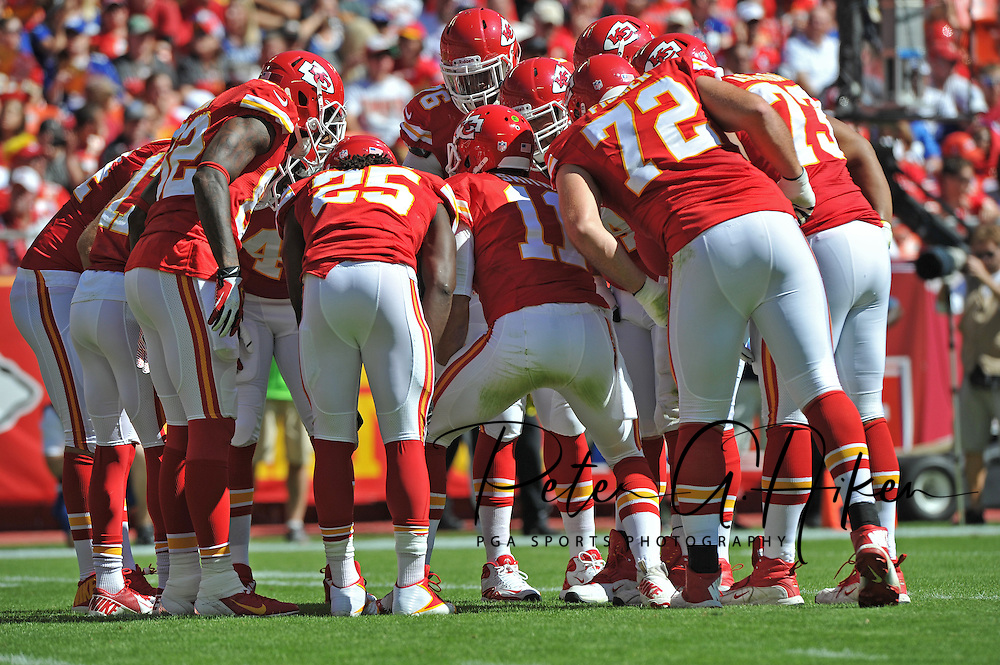 KANSAS CITY, MO - SEPTEMBER 29:  Quarterback Alex Smith #11 of the Kansas City Chiefs calls out a play in the huddle against the New York Giants during the first half on September 29, 2013 at Arrowhead Stadium in Kansas City, Missouri.  (Photo by Peter G. Aiken/Getty Images) *** Local Caption *** Alex Smith