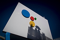 Shadows of attendees are seen on the wall of the Google Inc. booth during the 2018 Consumer Electronics Show (CES) in Las Vegas, Nevada, U.S., on Thursday, Jan. 11, 2018. Electric and driverless cars will remain a big part of this year's CES, as makers of high-tech cameras, batteries, and AI software vie to climb into automakers' dashboards. Photographer: David Paul Morris