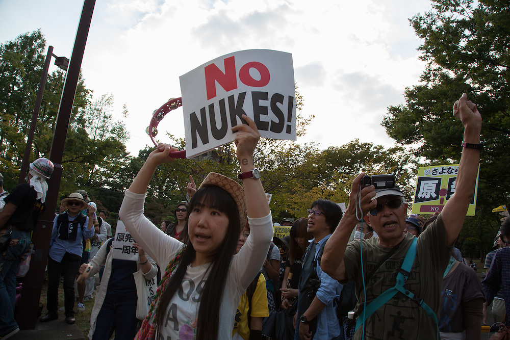 TOKYO (September 23) As Japan's nuclear regulator agency gives final safety approvals for the restart of two reactors at the Sendai nuclear plant in the prefecture of Kagoshima, sixteen thousand anti-nuclear protestors rally in Kameido Park in opposition. The Fukushima nuclear plant meltdown that followed the March 11th, 2011 tsunami forced the country to shut down all plants for inspection. Only a year since the last plant ceased to operate in September 2013, Japan is planning to restart the first plant towards the end of 2014 or first quarter of 2015. Activists calling for a nuclear free country are advocating towards the use of cleaner alternative energy and the complete eradication of seismic Japan's dependence on nuclear power.