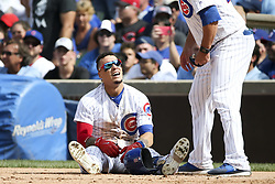 August 17, 2017 - Chicago, IL, USA - The Chicago Cubs' Javier Baez sits on the ground after being tagged out by Cincinnati Reds first baseman Joey Votto, not pictured, during the fifth inning at Wrigley Field in Chicago on Thursday, Aug. 17, 2017. The Reds won, 13-10. (Credit Image: © Armando L. Sanchez/TNS via ZUMA Wire)