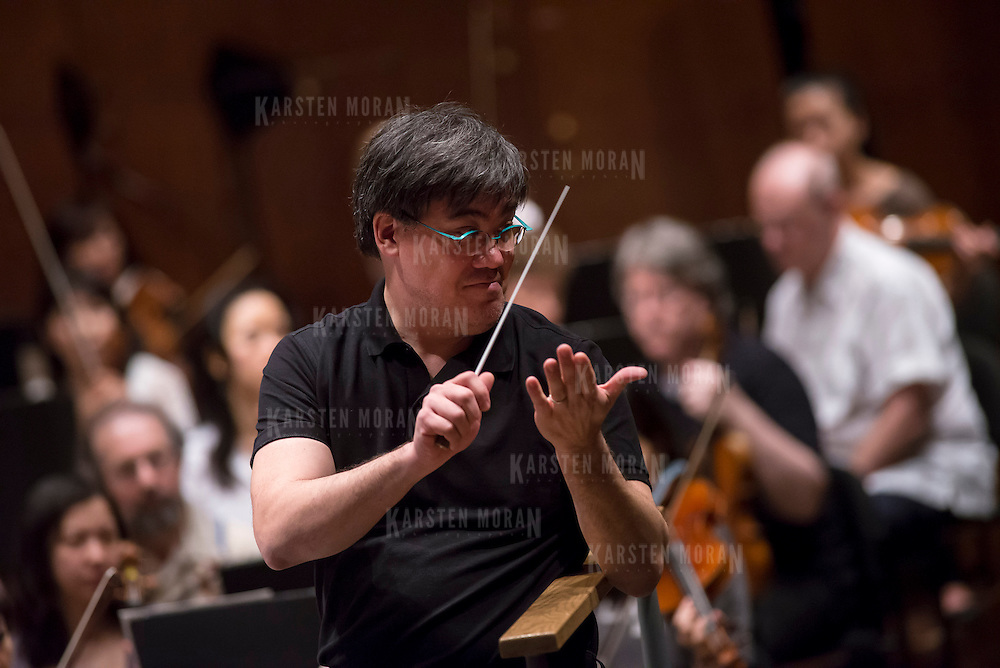 June 3, 2014 - New York, NY : New York Philharmonic Music Director Alan Gilbert applauds after leading the Philharmonic as they rehearse a piece by an up-and-coming composer at Avery Fisher Hall on Tuesday. Works by three little-known composers (one each) will be selected for inclusion in the New York Philharmonic's Biennial. CREDIT: Karsten Moran for The New York Times