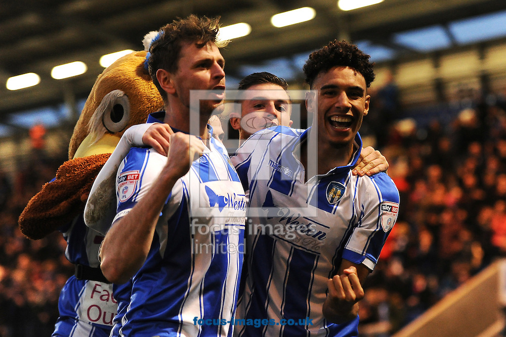 Kurtis Guthrie of Colchester United (right) celebrates scoring his sides third goal to make the scoreline 3-1 with Chris Porter of Colchester United (left) during the Sky Bet League 2 match between Colchester United and Carlisle United at the Weston Homes Community Stadium, Colchester<br /> Picture by Richard Blaxall/Focus Images Ltd +44 7853 364624<br /> 07/01/2017