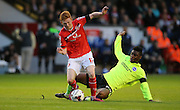 Walsall midfielder, Reece Flanagan is fouled by Brighton central midfielder, Rohan Ince during the Capital One Cup match between Walsall and Brighton and Hove Albion at the Banks's Stadium, Walsall, England on 25 August 2015.