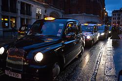 © Licensed to London News Pictures. 05/02/2014. London, UK. London Early morning taxis queue at Liverpool Street Station for passengers this morning causing traffic jams. Underground union members from the RMT and TSSA unions have gone on a 48 hour strike, which started at 9pm on 4th February 2014, over proposals by Transport for London (TfL) to cut jobs and close ticket offices. Photo credit : Vickie Flores/LNP