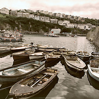Fishing boats moored in a small harbour in Cornwall England