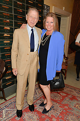 EDWARD FOX and his daughter VISCOUNTESS GORMANSTON at The House of Britannia reception hosted by Lady Delves Broughton at 42 Berkeley Square, London on 26th June 2014.