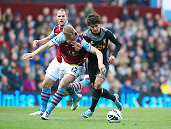 BIRMINGHAM, ENGLAND - Easter Sunday, March 31, 2013: Liverpool's Philippe Coutinho Correia in action against Aston Villa's Nathan Baker during the Premiership match at Villa Park. (Pic by David Rawcliffe/Propaganda)