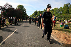 UK ENGLAND WEST SUSSEX BALCOMBE 26JUL13 - Police show a presence as local residents protest at the Cuadrilla hydraulic fracking drill site in Balcombe, West Sussex.<br /> <br /> <br /> <br /> Cuadrilla plans to start drilling a 3,000ft (914m) vertical well and a 2,500ft (762m) horizontal bore to the south of the village in search for oil and gas resources.<br /> <br /> <br /> <br /> jre/Photo by Jiri Rezac<br /> <br />  / GREENPEACE<br /> <br /> &copy; Jiri Rezac 2013