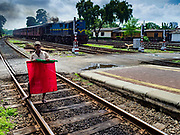 07 OCTOBER 2017 - COLOMBO, SRI LANKA: A flagman signals a closed track at the Fort Station in Colombo. The Fort Station is Colombo's main train station and serves as the hub of Sri Lanka's train system. The station opened in 1917 and is modeled after Manchester Victoria Station.    PHOTO BY JACK KURTZ