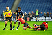 Viliame Mata (#8) of Edinburgh Rugby is tackled by Martinus Burger (#7) of Isuzu Southern Kings during the Guinness Pro 14 2018_19 rugby match between Edinburgh Rugby and Isuzu Southern Kings at the BT Murrayfield Stadium, Edinburgh, Scotland on 5 January 2019.