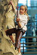 Alexandra Herrera climbs the rock wall during Ping Fest. She was in town to visit her cousin and OU sophomore Sarah Peterson for Sibs Weekend.