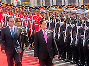 23 JULY 2015 - BANGKOK, THAILAND:  NGUYEN TAN DUNG (center), Prime Minister of Vietnam,  and PRAYUTH CHAN-O-CHA, Prime Minister of Thailand, (left) review soldiers in the honor guard at Government House in Bangkok. The Vietnamese Prime Minister and his wife came to Bangkok for the 3rd Thailand - Vietnam Joint Cabinet Retreat. The Thai and Vietnamese Prime Minister discussed issues of mutual interest.     PHOTO BY JACK KURTZ