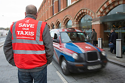 © licensed to London News Pictures. London, UK 23/11/2012. Workers of London Taxi Company, which makes black cabs, staging a protest outside St Pancras Station in London as part of a campaign to save jobs after 156 workers lost their jobs. Photo credit: Tolga Akmen/LNP