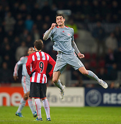 EINDHOVEN, THE NETHERLANDS - Tuesday, December 9, 2008: Liverpool's Albert Riera celebrates scoring the second goal against PSV Eindhoven during the final UEFA Champions League Group D match at the Philips Stadium. (Photo by David Rawcliffe/Propaganda)