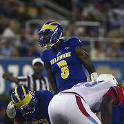 Delaware Quarterback JOE WALKER (3) attempts to call a play during a week one game between the Delaware Blue Hens and the Delaware State Hornets, Thursday, Sept. 01, 2016 at Tubby Raymond Field at Delaware Stadium in Newark, DE.