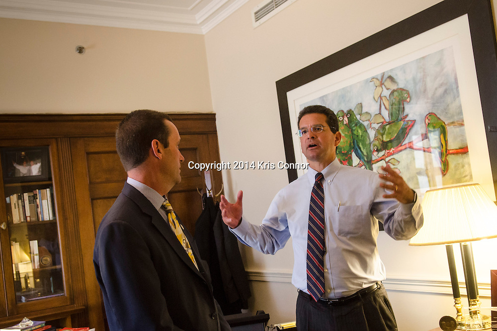 Representative-elect Steve Knight(CA-25) speaks with Rep. Pedro R. Pierluisi(PR) in Pierluisi's office in the of Longworth House Office Building about possibly selecting his office on November 19, 2014. Knight drew first choice in the House of Representatives' new members office lottery earlier in the day. Photo by Kris Connor