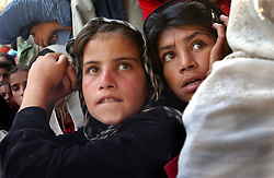 """KABUL,AFGHANISTAN - AUGUST 29: Afghan street children watch a Japanese dancer perform a piece called """"Reconstruction"""" at the ASIANA school August 29, 2002 in Kabul Afghanistan.  The Japanese program concluded with 1000 musical instruments donated to the children.  (Photo by Ami Vitale/Getty Images)"""