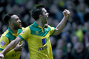 Jonny Howson scores a goal and celebrates during the Sky Bet Championship match between Norwich City and Brighton and Hove Albion at Carrow Road, Norwich, England on 22 November 2014.