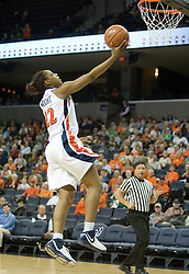 Virginia's Monica Wright (22) jumps to the basket against BC.  The Cavaliers defeated the Eagles 65-63 in overtime at the John Paul Jones Arena in Charlottesville, VA on January 14, 2007.