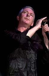 Thunder lead singer Danny Bowes on stage at the Monsters of Rock Festival. Last night of an eleven date tour at the Hallam FM Arena, Sheffield Tuesday 26th November 2002<br /> <br /> Copyright Paul David Drabble<br /> Freelance Photographer<br /> 07831 853913<br /> 0114 2468406<br /> www.pauldaviddrabble.co.uk<br /> [#Beginning of Shooting Data Section]<br /> Nikon D1 <br /> 2002/11/26 20:13:58.4<br /> JPEG (8-bit) Fine<br /> Image Size:  2000 x 1312<br /> Color<br /> Lens: 80-200mm f/2.8-2.8<br /> Focal Length: 135mm<br /> Exposure Mode: Manual<br /> Metering Mode: Spot<br /> 1/250 sec - f/2.8<br /> Exposure Comp.: 0 EV<br /> Sensitivity: ISO 400<br /> White Balance: Auto<br /> AF Mode: AF-S<br /> Tone Comp: Normal<br /> Flash Sync Mode: Front Curtain<br /> Auto Flash Mode: External<br /> Color Mode: <br /> Hue Adjustment: <br /> Sharpening: Normal<br /> Noise Reduction: <br /> Image Comment: <br /> [#End of Shooting Data Section]