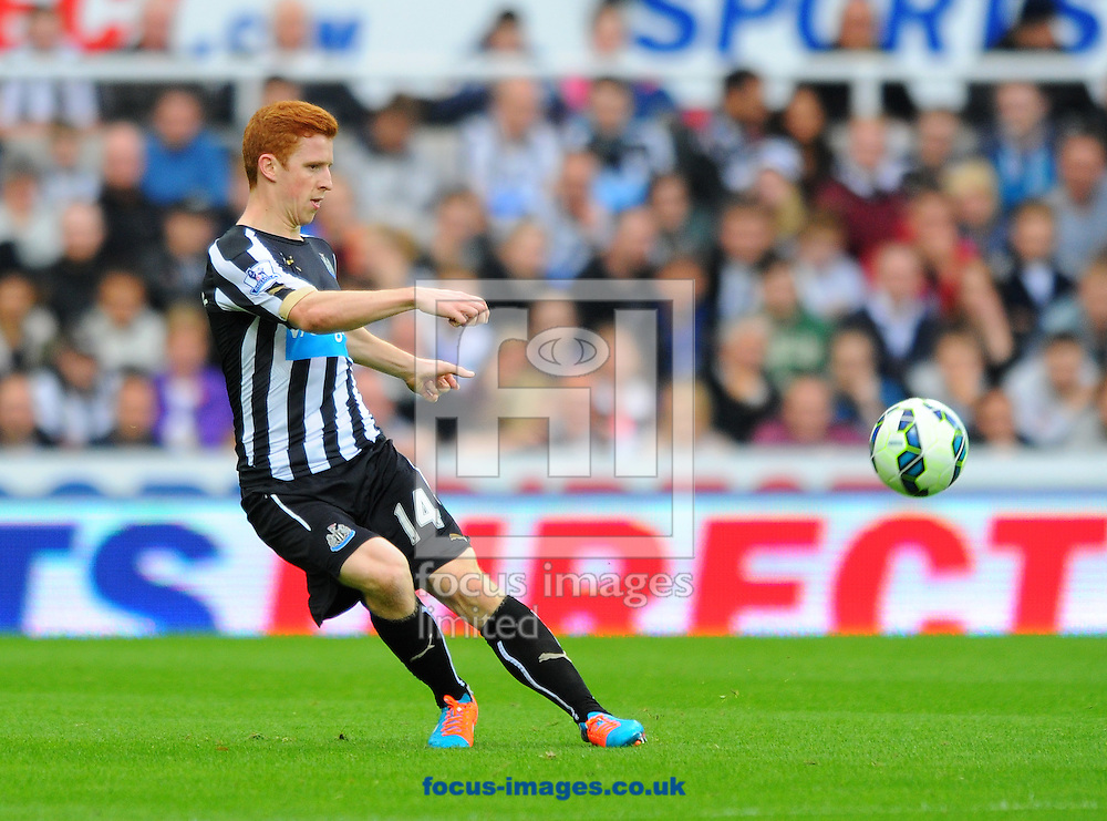 Jack Colback of Newcastle United passes the ball during the Barclays Premier League match at St. James's Park, Newcastle<br /> Picture by Greg Kwasnik/Focus Images Ltd +44 7902 021456<br /> 18/10/2014