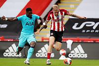 Football - 2019 / 2020 Premier League - Sheffield United vs Tottenham Hotspur<br /> Oliver McBurnie of Sheffield United and Serge Aurier of Tottenham Hotspur, at Bramall Lane.<br /> <br /> COLORSPORT/PAUL GREENWOOD