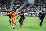 Houston Dynamo midfielder Tomas Martinez (10) tries to ward off LAFC defender Mohamed El-Munir (13) during a MLS soccer game, Saturday, Sept 25, 2019, in Los Angeles. LAFC wins 3-1. (Jon Endow/Image of Sport)
