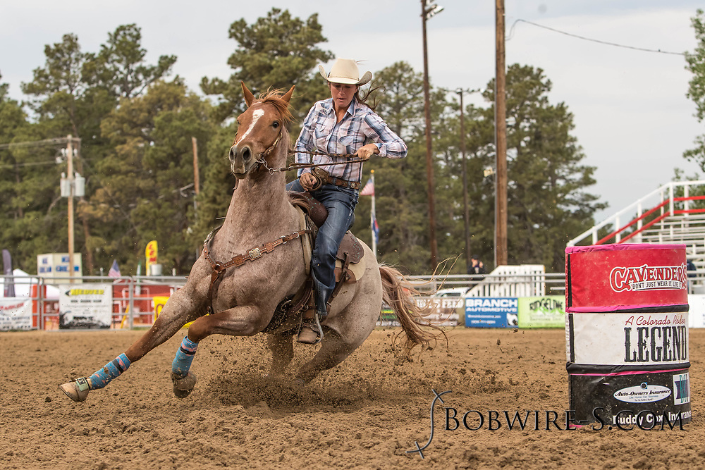 CJ Vondette makes her barrel racing run during slack at the Elizabeth Stampede on Sunday, June 3, 2018.