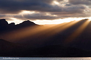 Sunset rays pour over the Sierra de la Giganta mountain range near Loreto Mexico