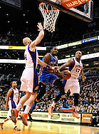 Jan. 14, 2013; Phoenix, AZ, USA; Oklahoma City Thunder forward Kevin Durant (35) goes up with the ball against the Phoenix Suns forward P.J. Tucker (17) and center Marcin Gortat (4) in the first half at US Airways Center. Mandatory Credit: Jennifer Stewart-USA TODAY Sports