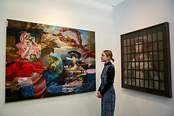 """© Licensed to London News Pictures. 21/01/2020. London, UK. A woman views Simon Casson's artwork titled """"Tantarabobus Misk' during the preview of London Art Fair at Business Design Centre in north London. The fair opens on 22 January and runs until 26 January, which showcases modern and contemporary artwork from galleries around the world. Photo credit: Dinendra Haria/LNP"""