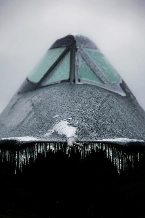 Freezing rain encased the upper half of a SR-71 Blackbird and formed icicles along the leading and trailing edge of the static display aircraft at Lackland Air Force Base, TX, during a cold weather snap in San Antonio. TX on Jan 16, 2007. When the aircraft was operational it flew at more than three times the speed of sound. (Photo/Lance Cheung)