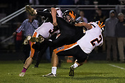 Hanover's Dylon Stair (3) and Jeffrey Jacoby (2) tackle a Biglerville player during a football game between Biglerville and Hanover on Friday, Oct. 27, 2017 in Biglerville. The Hanover Nighthawks won 44-41 against the Biglerville Canners.