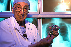 Portrait of Surgeon Dr. Michael DeBakey Holding Heart Pump