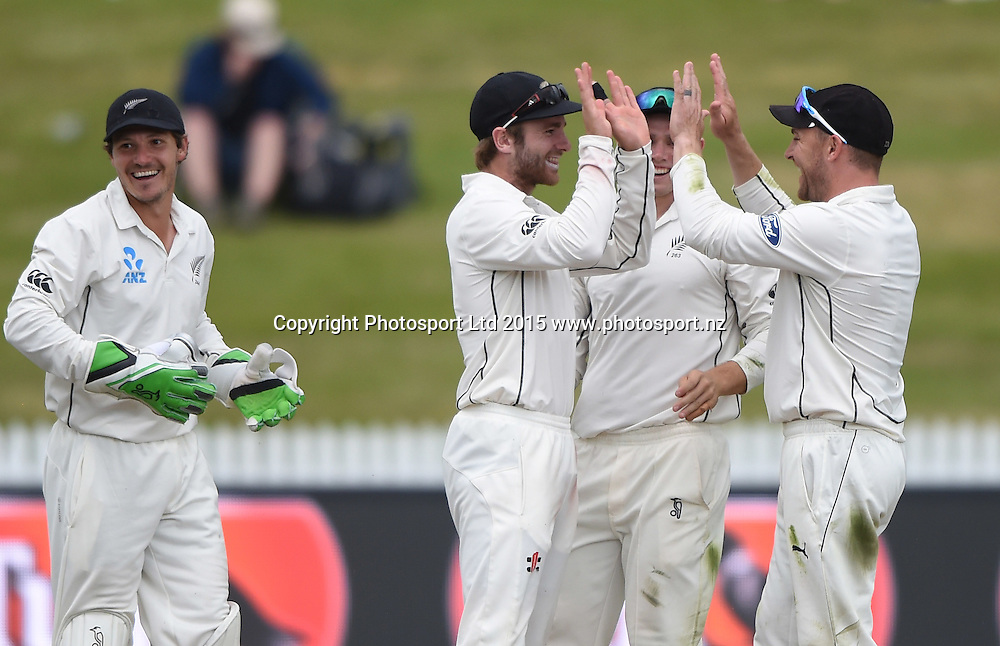 Kane Williamson celebrates with team mates after his run out of  Herath on day 1 of the 2nd cricket test match between New Zealand Black Caps and Sri Lanka at Seddon Park in Hamilton, New Zealand. Friday 18 December 2015. Copyright photo: Andrew Cornaga / www.photosport.nz