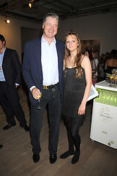 The MARQUESS OF WORCESTER and his daughter LADY BELLA SOMERSET at the Quintessentailly Summer Party at the Phillips de Pury Gallery, 9 Howick Place, London on 9th July 2008.<br />