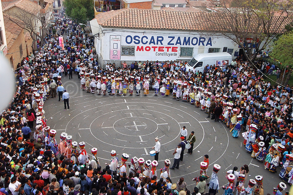 """Bolivia. Tarija. Festa di San Roque..The Chunchos """"widen"""" the square cowboy boots to start a choreography for which the circles are drawn on the ground."""
