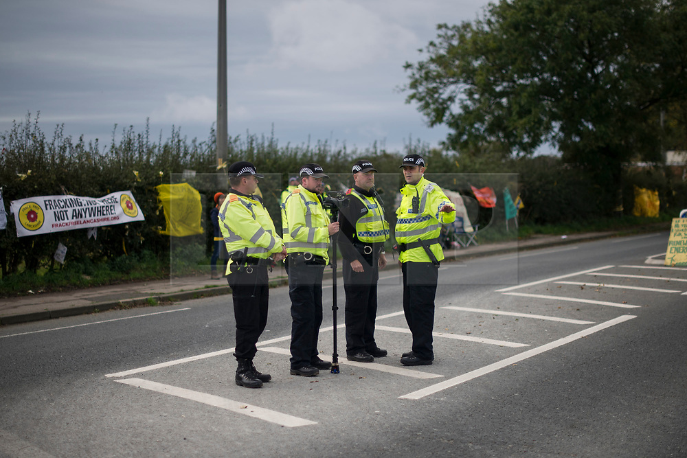 © Licensed to London News Pictures. 09/10/2017. Lancashire, UK.  Police monitor the Anti-Fracking Demonstration on Preston New Road Lancashire at the entrance to Cuadrillas Hydraulic fracking site. The Demo brought together activists from Greenpeace, The Green Party and the local community to protest against the drilling taking place at the site.  Photo credit: Steven Speed/LNP