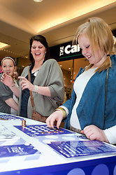 Cadburys Spots vs Stripes Challenge Race Season Meadowhall Sheffield.fastest coin stacker challange.2 April 2011.Images © Paul David Drabble