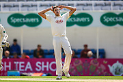 Morne Morkel of Surrey concedes four runs during the Specsavers County Champ Div 1 match between Surrey County Cricket Club and Hampshire County Cricket Club at the Kia Oval, Kennington, United Kingdom on 18 August 2019.