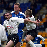 St Johnstone v Clyde..  05.10.02<br />Stephen Convery and Alan Kernaghan clear from Ian Maxwell<br /><br />Pic by Graeme Hart<br />Copyright Perthshire Picture Agency<br />Tel: 01738 623350 / 07990 594431