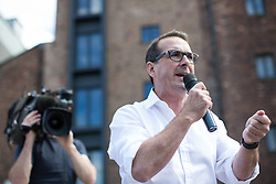 © Licensed to London News Pictures . 30/07/2016 . Liverpool , UK . OWEN SMITH holds a rally in a field off Bridgewater Street in Liverpool after the booked venue , the Camp and Furnace warehouse , reportedly cancelled the booking . Smith is campaigning to replace Jeremy Corbyn as the leader of the Labour Party . Photo credit : Joel Goodman/LNP