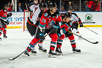 KELOWNA, BC - NOVEMBER 8:  Tyler Preziuso #22 of the Medicine Hat Tigers back checks Leif Mattson #28 and Trevor Wong #8 of the Kelowna Rockets during first period at Prospera Place on November 8, 2019 in Kelowna, Canada. (Photo by Marissa Baecker/Shoot the Breeze)