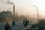 Air pollution near the Number One coal fired power plant. 75% of China's growing energy needs is supplied by coal, the cheapest and dirtiest form of energy. China is the world's largest producer of coal. Seven of the world's ten most polluted cities are in China, largely due to coal use and the country's dilapidated heavy industries.<br /> D&agrave;t&oacute;ng, Shanxi Province, China. 12/11/2005<br /> Photo &copy; J.B. Russell