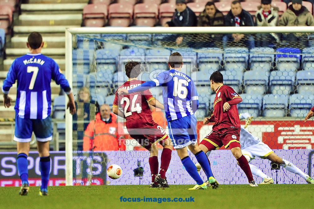 Picture by Ian Wadkins/Focus Images Ltd +44 7877 568959<br /> 28/11/2013<br /> James McArthur of Wigan Athletic shoots at goal during the UEFA Europa League match at the DW Stadium, Wigan.